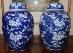 A pair of Chinese blue and white jars and covers, c.1900, Kangxi mark (one a.f.)