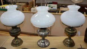 Three brass oil lamps with shades tallest 60cm