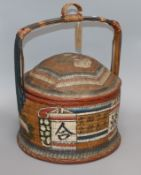 An Oriental painted wicker food carrier