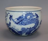 A Chinese blue and white 'dragon' jardiniere height 16cm