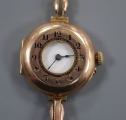 A lady's early 20th century 9ct Rolex half hunter manual wind wrist watch, on a yellow metal