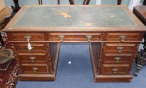 An Edwardian oak pedestal desk W.138cm