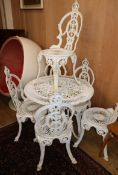 A circular white painted aluninum garden table and six chairs Table 80cm diameter