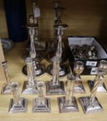 Four pairs of silver plated candlesticks, seven singular and sconces