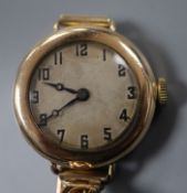 An early 20th century gold plated manual wind watch, the movement signed Rolex, on a 9ct expanding