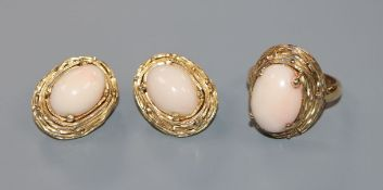 A pair of 18k yellow metal and cabochon coral set earrings and matching dress ring.