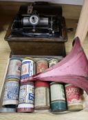 An Edison Standard Phonograph with cylinder in an oak case, pink painted horn and eight wax