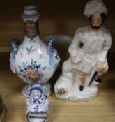 A French faience pilgrim flask, a delft figure, a Staffordshire figure and Victorian chamberpot