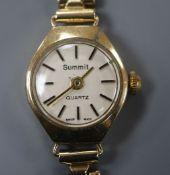 A ladys' 9ct gold Summit wristwatch on flexible link bracelet, gross 13.2 grams.