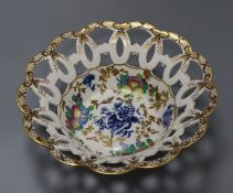 A Worcester blue and white printed and polychrome painted cake basket (a.f.)