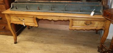 A French fruitwood writing table W.188cm