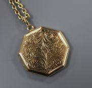 A 9ct engraved gold octagonal enclosed locket on a 375 oval link chain, gross 9.2 grams.