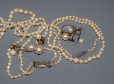 Two cultured pearl necklaces, including twin strand, a pair of cultured pearl earrings, one other