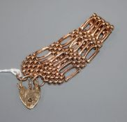 A 9ct rose gold flexible gate-link bracelet with padlock clasp, 23.1 grams.