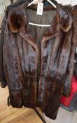 A three quarter length mink coat