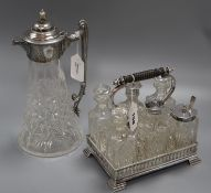 A cut glass claret jug with silver-plated mounts and a six-bottle plated cruet set
