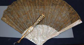 A black and gold spangled cloth fan, circa 1900-1910 and an Art Nouveau spun silk fan, the former