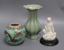 A Celadon glazed vase, a blanc de chine figure and a dragon jar vase 21cm