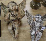 Two 19th century Continental polychrome wood cherubs tallest 52cm