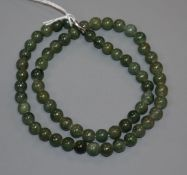 A Chinese green stone bead necklace