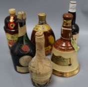 Six assorted spirits including Bells