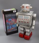 A Horikawa SH 'Space Giant' battery-operated tinplate robot and similar Horikawa 'Super Robot', both