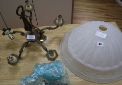 An opaque light bowl and a copper light fitting