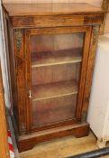 A Victorian inlaid walnut pier cabinet W.63c,