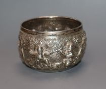 A rare Burmese white metal miniature bowl, embossed with figures in landscape scene, floral mark
