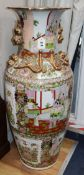 A Canton famille rose large floor vase decorated with panels of figures and flowers height 94cm