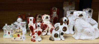 A quantity Victorian Staffordshire chimney dogs and houses