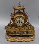 A gilt metal and porcelain mantel clock height 37cm
