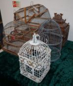 A Chinese wired birdcage with blue and white water feeders and four other wood and wirework