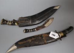 A Kukri knife, another and an Indian knife