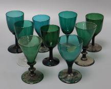 Nine various 19th century green wine glasses