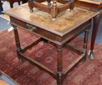 A 17th century style oak side table W.83cm