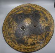An Indian papier mache shield, depicting hunting tigers and a lion diameter 55cm