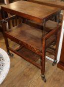 An oak folding tea trolley W.69cm