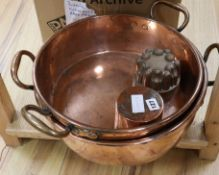 Two Victorian copper jam pans and two copper jelly moulds