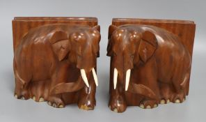A pair of elephant book ends height 15cm