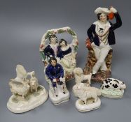 A group of Staffordshire pottery figures and animals