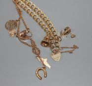 A 9ct yellow gold curb-link bracelet with two charms and padlock clasp and a similar bracelet hung