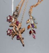 A 9ct gold, ruby and diamond set floral spray brooch and a 9ct gold and gem set pendant on a 9ct