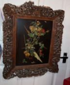 A Chinese carved wood framed panel