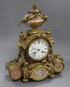 A 19th century Louis XVI style ormolu mantel clock inset with porcelain panels height 38cm