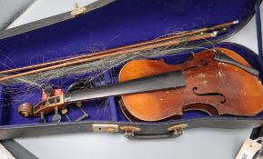 A 19th century European violin, cased with two bows