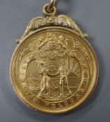 A 9ct gold 'Lydney's Welcome Home' medallion to J. Watts, hallmarked for Birmingham, 1918, 10.6