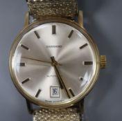 A gentleman's yellow metal automatic wrist watch retailed by Garrard, on associated flexible