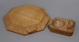 A Robert 'Mouseman' Thompson octagonal oak cheese board/pot stand and an ashtray, each with carved