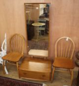 An Ercol elm cheval mirror and two Ercol comb back chairs